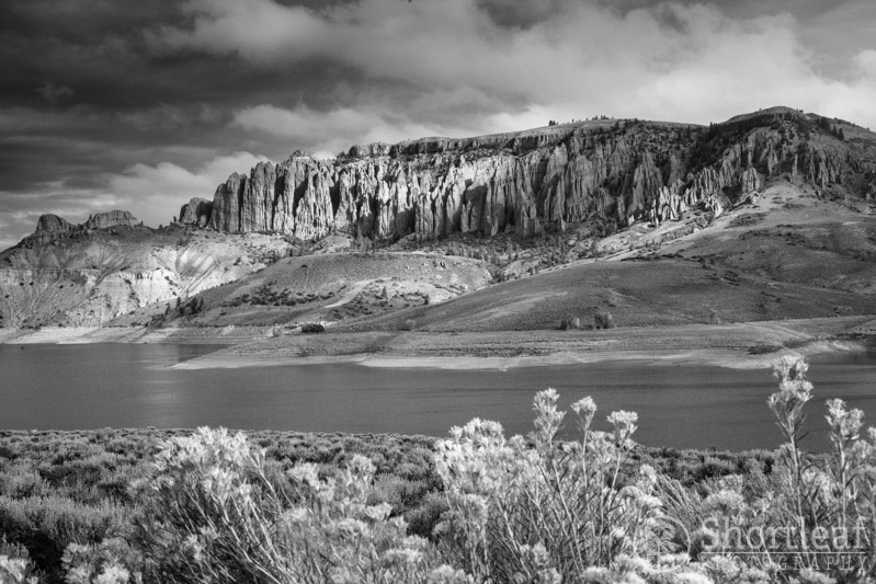 The broken clouds created scattered pools of light on the landscape. These jagged cliffs are above Blue Mesa Reservoir. The cliffs probably have a name, but I don't know what it is.